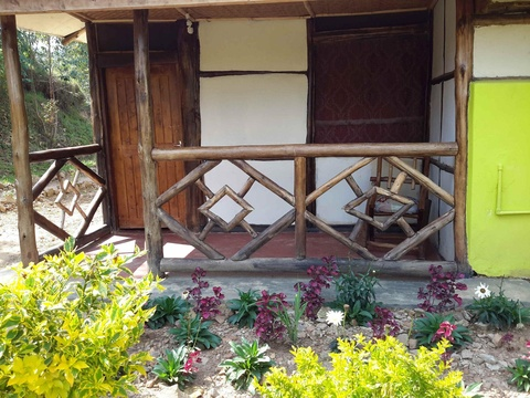 Hand crafted cottage with toilet and bathroom inside with all views of Bwindi Forest